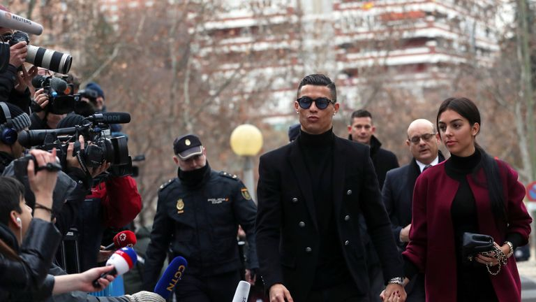 Cristiano Ronaldo arrives with his girlfriend Georgina Rodriguez to appear in court on a trial for tax fraud in Madrid, Spain, January 22, 2019. REUTERS/Susana Vera