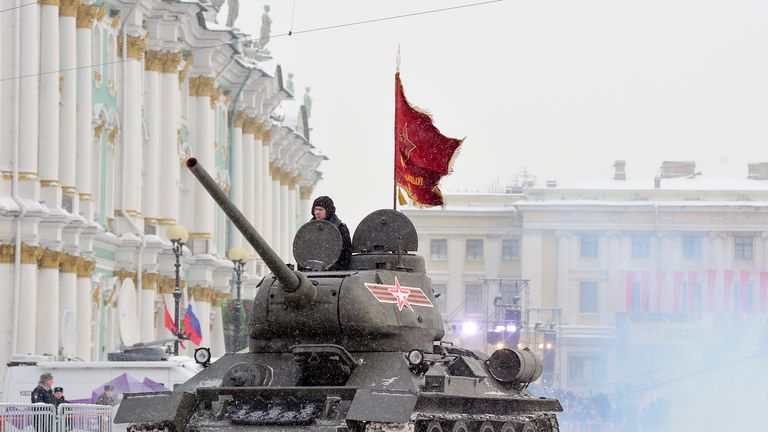 A Soviet WWII-era T-34 tank drives during the military parade in Saint Petersburg