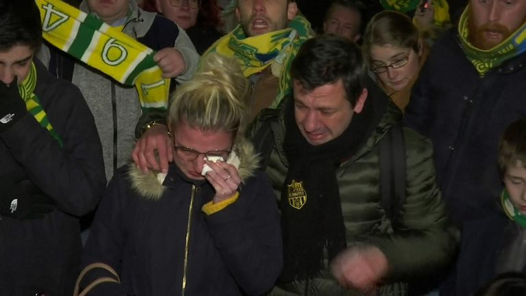 Gathered in Nantes' Place Royale, fans waved banners, lit flares, and chanted Sala's name.
