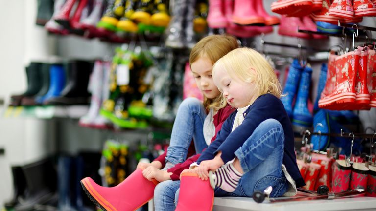 Children getting their shoes fitted will also get language help. File pic