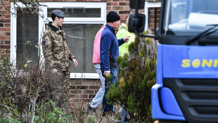 Contractors and military personnel outside the Skripal home