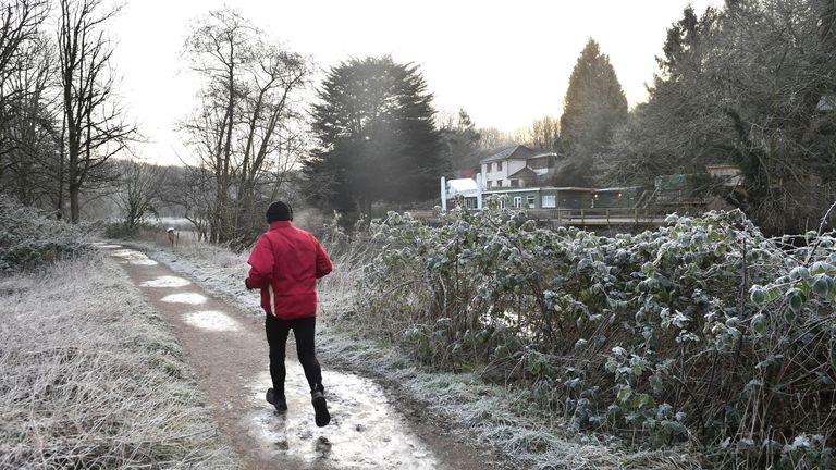 A jogger running by the River Avon in Bristol after the UK had its coldest night of winter so far