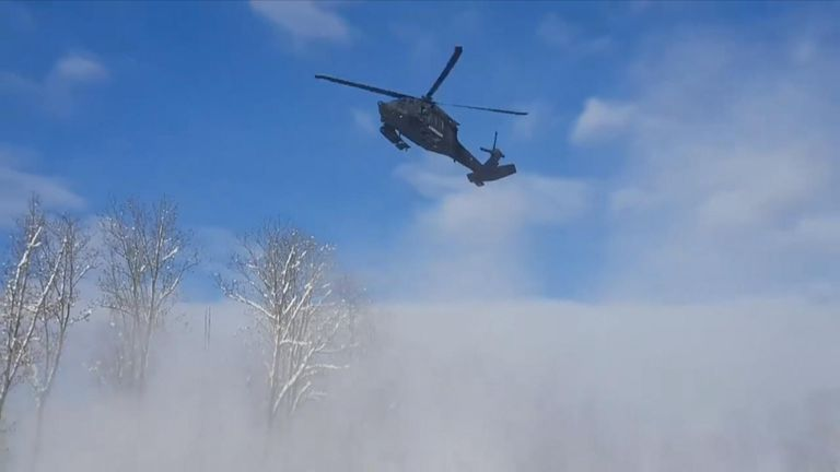 The Austrian Armed Forces has used a Black Hawk helicopter to monitor avalanches and dislodge snow from trees.