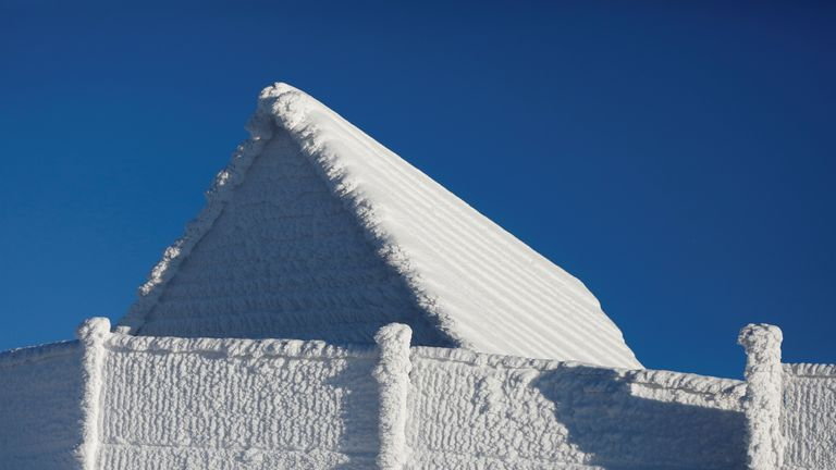 A house is buried under snow at the mountain resort in Szczyrk, Poland