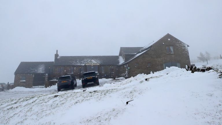Snow covers the ground outside the Peak View tea rooms near Macclesfield