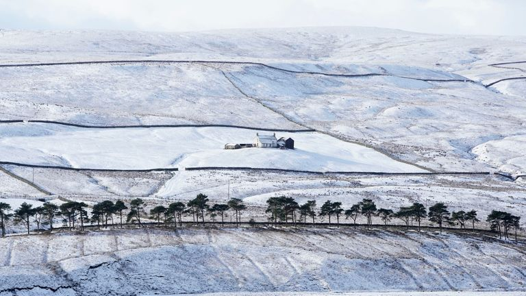 A farmhouse in Teesdale surrounded by snow