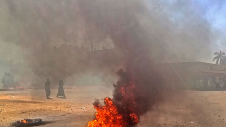 Sudanese protesters burn tires during an anti-government demonstration