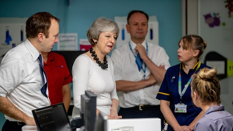 Theresa May and Matt Hancock meet NHS staff