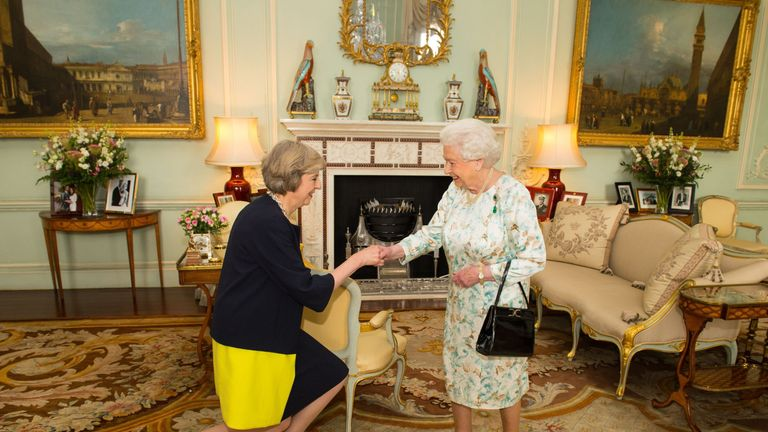 Queen Elizabeth II welcomes Theresa May at the start of an audience in Buckingham Palace, London, where she invited the former Home Secretary to become Prime Minister and form a new government.