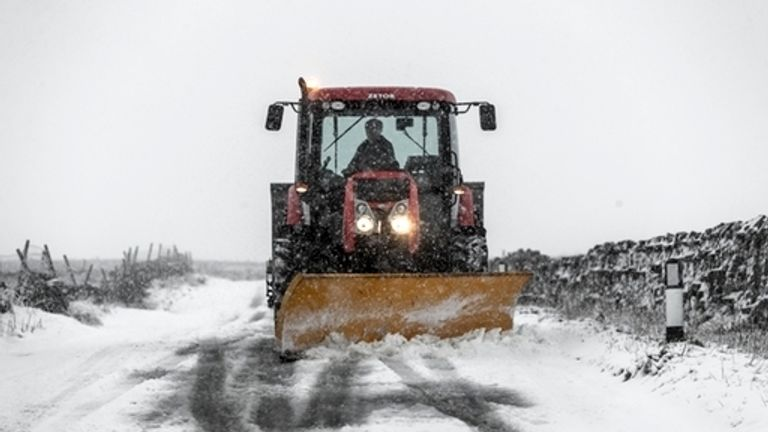 A snowplough clears a road in Thwaite in Yorkshire