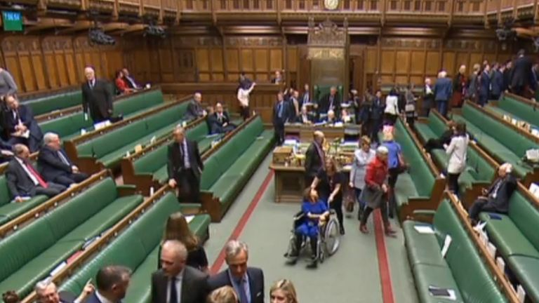 Labour MP Tulip Siddiq is wheeled through the chamber while MPs vote on the Prime Minister's Brexit deal