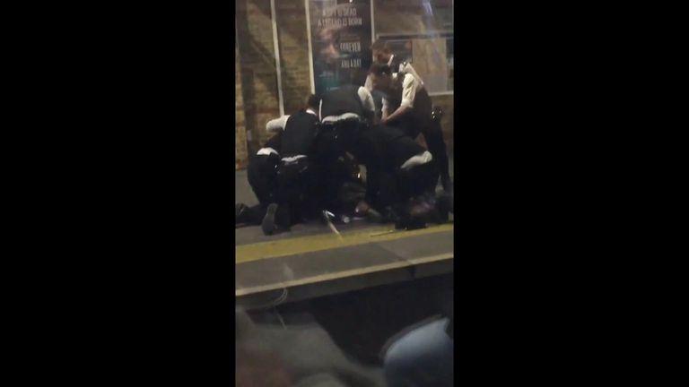 Police subdue the man with the machete Pic: Xara Pandora