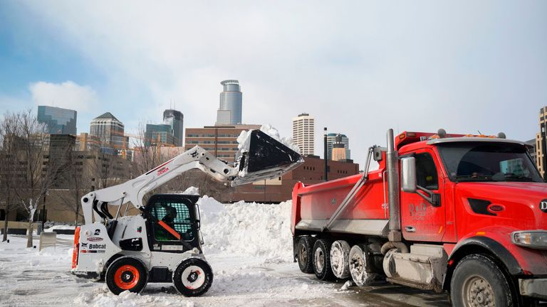 Snow is cleared in Minneapolis, where temperatures could drop as low as -70C (-94F)