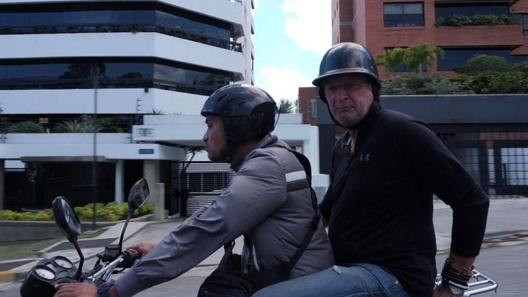 The Sky team had to move around Caracas on motorbikes