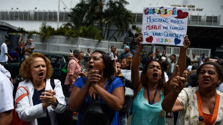 Women in Caracas protest as part of anti-government protests called by Venezuelan opposition leader Juan Guaido