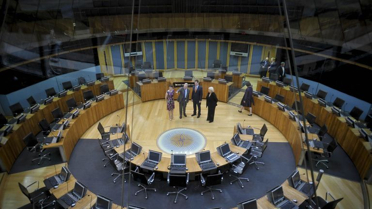 The Deputy Prime Minister Nick Clegg (2nd right) is shown the inside of the Siambr, where the Welsh Assembly sit, with Welsh Liberal Democrat leader Kirsty Williams (left), Presiding Officer of the National Assembly of Wales Lord Dafydd Elis-Thomas (second left) and the Secretary of State for Wales Cheryl Gillan (right).