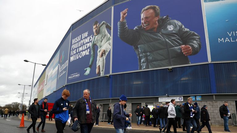 The Cardiff City Stadium has 'visit the Philippines' and 'visit Malaysia' adverts on its outside walls