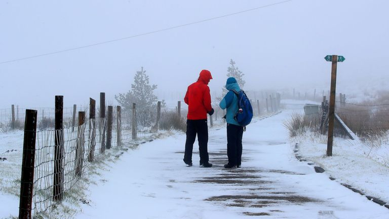 Walkers on a snow-covered path near Macclesfield