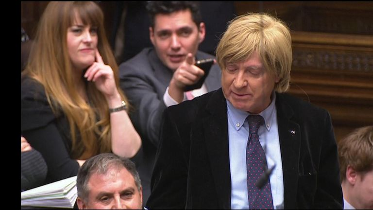 Huw Merriman MP appears to be mocking his fellow Tory MP Michael Fabricant for wearing a wig during PMQs