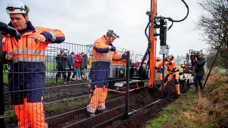 Danish workers started erecting the fence in Padborg on Monday