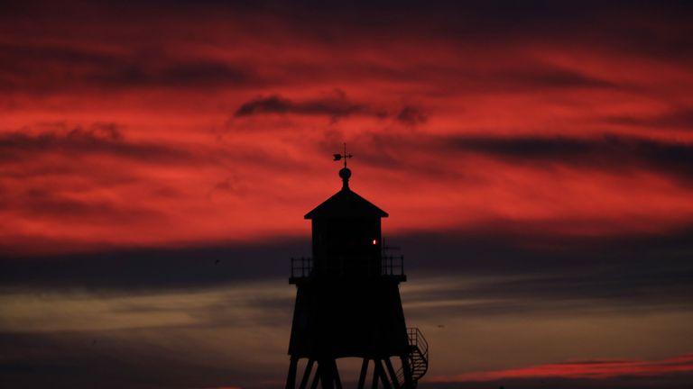 Sunrise over the Herd Groyne Lighthouse in South Shields