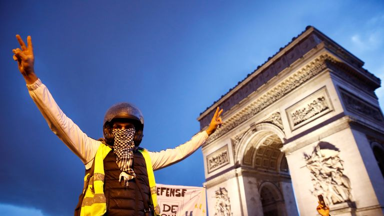 """DATE IMPORTED:22 December, 2018A protester wearing a yellow vest takes part in a demonstration by the """"yellow vests"""" movement near the Arc de Triomphe in Paris, France, December 22, 2018. REUTERS/Christian Hartmann"""