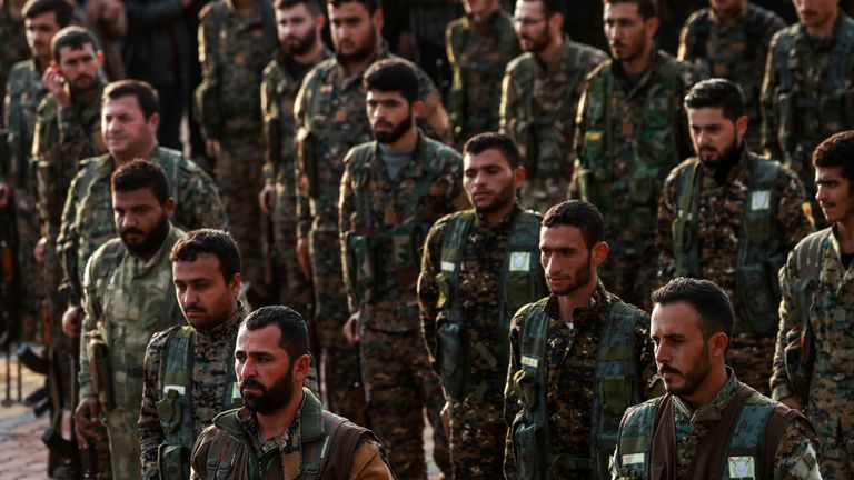 Syrian Kurdish members of the People's Protection Units (YPG) attend the funeral of a slain Kurdish commander in the northeastern city of Qamishli on December 6, 2018