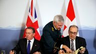 Liam Fox signed the trade deal in the Swiss city of Bern