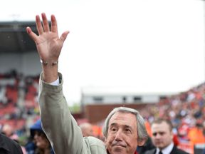 Gordon Banks waves to fans at a Premier League match between Stoke City and Tottenham Hotspur