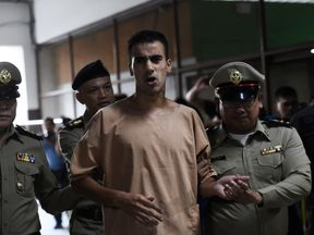 Hakeem al Araibi is escorted to a courtroom in Bangkok