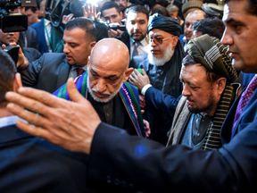 Former Afghan president Hamid Karzai arrives for peace talks in Moscow