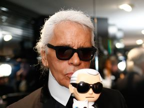 Karl Lagerfeld with his doll in Munich in 2013