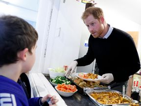 Prince Harry persuaded children to have some salad with their lunch