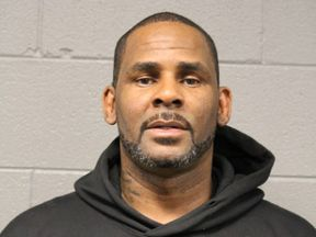 R Kelly's mug shot, taken by Chicago Police Department after his arrest