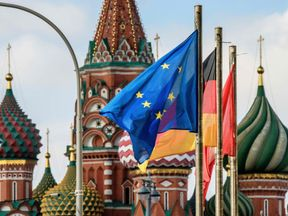 The European Union flag flies among others in front of St.Basil's Cathedral in Moscow on March 29, 2018. At least 25 countries have ordered out more than 120 Russia diplomats in response to the March 4 attack on former Russian double agent Sergei Skripal and his daughter in the English city of Salisbury. / AFP PHOTO / Mladen ANTONOV (Photo credit should read MLADEN ANTONOV/AFP/Getty Images)