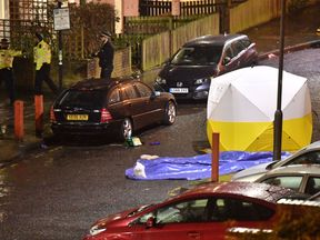 A police forensic tent at the scene of the stabbing