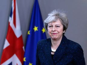 Theresa May speaks to the press at the European Council headquarters in Brussels