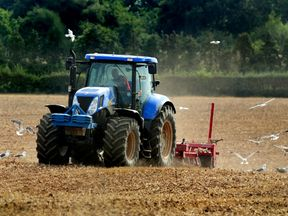 """File photo dated 01/09/13 of a of tractor ploughing a field in Leicestershire, as British farmers and growers should remain the """"number one supplier of choice"""" to UK consumers after Brexit, farming leaders have urged."""
