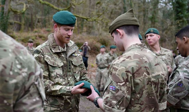 Prince Harry presents Royal Marines with green berets