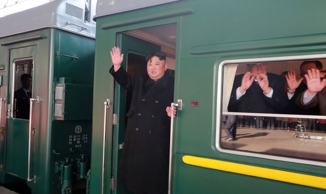 Kim Jong Un waves from armoured train as he heads to Trump summit