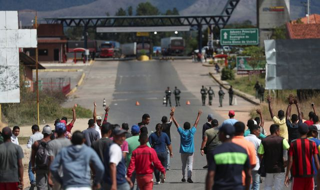 Woman killed in clashes on Venezuela and Brazil border as Richard Branson stages concert