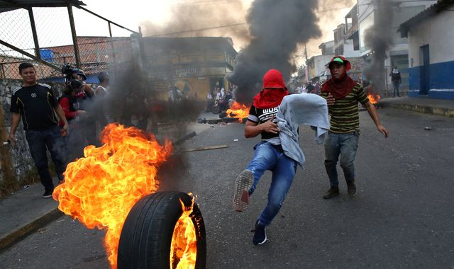 Running battles on Venezuela border over aid after Branson concert