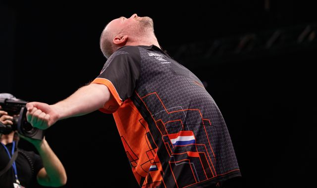 Raymond van Barneveld keeps Premier League Darts hopes alive as Michael van Gerwen is beaten