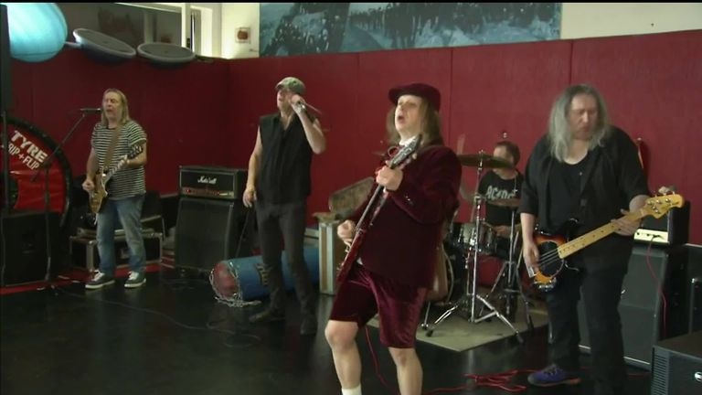 WATCH: Wigan Warriors rock out to AC/DC tribute act | Rugby League News |