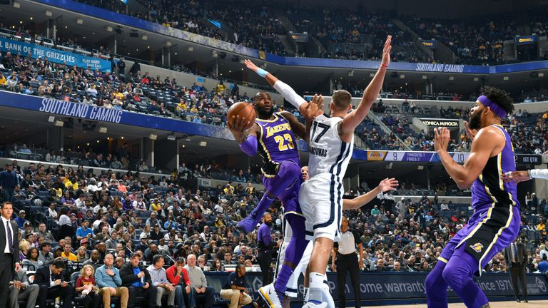 d4947ad1e8ac LeBron James lofts a scoop shot during the Los Angeles Lakers loss in  Memphis