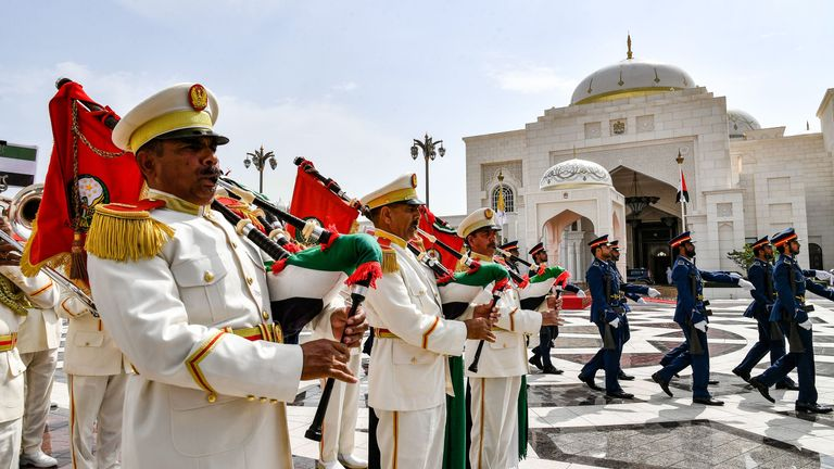 A military band performs as an honour guard marches by during the welcome ceremony for the visiting Pope Francis
