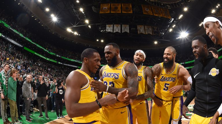 f2eb25ca8 Rajon Rondo is mobbed by his Lakers team-mates after hitting a game-winning