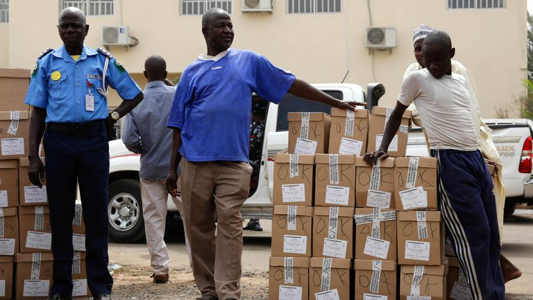 Staff wait to load election materials onto a truck for distribution in Yola
