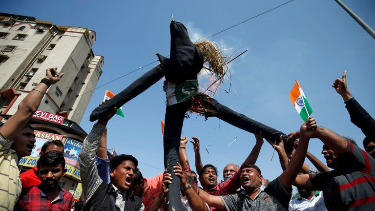 People in Ahmedabad, India, burn an effigy depicting Pakistan as they celebrate the air strikes 