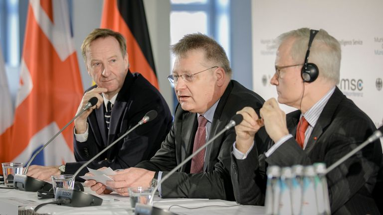 The head of MI6, Alex Younger (left), on a panel in Munich